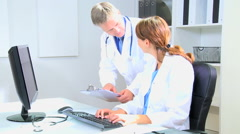 Western European male female doctor medical executive team computer technology Stock Footage