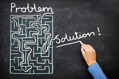 Problem and solution - solving maze - stock photo