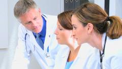 Caucasian male female medical consultant financial planning computer technology - stock footage