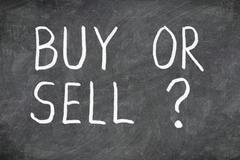 Buy or sell question on blackboard Stock Photos