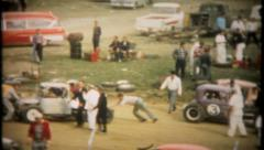 2098 - drivers & pit crews get ready for the race - vintage film home movie - stock footage