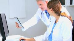Caucasian male female doctor consultant medical computer tablet technology Stock Footage