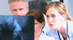 Caucasian male female doctor consultant medical computer hospital x-ray tests - stock footage