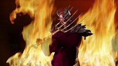 animation devil with a pitchfork in his hand against the flames of fire - stock footage