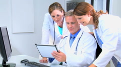 Western European male female doctor medical executive tablet computer technology Stock Footage