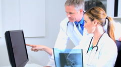 Caucasian male female doctor consultant medical computer hospital x-ray tests Stock Footage