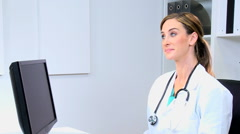 Western European male female doctor medical executive x-ray computer technology - stock footage