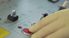 Finger presses red and green button on the remote control production Stock Footage