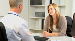 male female Caucasian patient medical consultant healthcare planning meeting - stock footage
