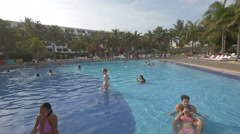 Happy people swimming in the pool at Oasis, Cancun - stock footage