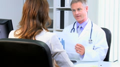 male female Caucasian medical consultant patient clinical healthcare meeting - stock footage