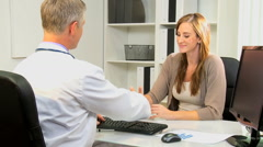 handshake medical clinic healthcare meeting male female doctor business finance - stock footage