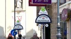 A pointer sign of a bus stop in Vienna Austria - Autobus haltestelle Stock Footage