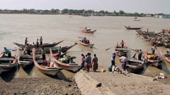 Dirty embankment of  river and poor people. Stock Footage