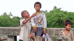 Poor, dirty, funny kids living in Myanmar Stock Footage