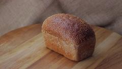 Fresh white bread with sesame seeds. Stock Footage