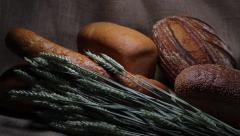 Bread on sackcloth with wheat spikelets. Stock Footage