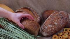 Collection of different sorts of bread on sackcloth. Stock Footage