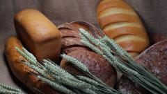Still life with different kinds of bread. Bread in sackcloth with spikelets. Stock Footage