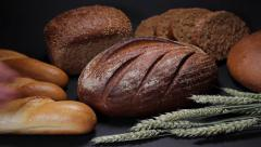 Replenishment of bread collection in the store. - stock footage