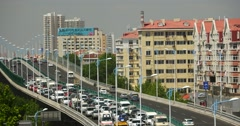 4k Modern urban city busy traffic on overpass,highway street & houses building. Stock Footage