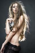 Crazy young naked woman with camera - stock photo