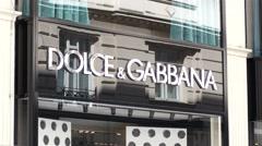 Dolce Gabbana signboard  - shopping in Vienna Austria - stock footage