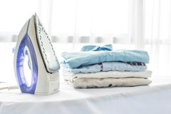 Ironing, clothes, housework and objects concept Stock Photos