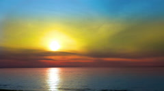 4K Beach Sunset Background Loop. Showing a close up the a romantic sunset ove - stock footage