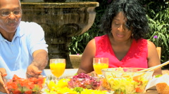 Senior retired African American couple male female healthy organic food outdoor Stock Footage