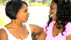 US African American happy family young mother daughter outdoors relaxation happy - stock footage