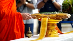 Monk poured water from a small water pot Stock Footage