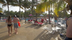 Sitting down and chatting near the pool at Grand Oasis Cancun - stock footage