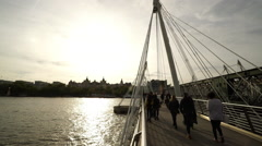 The Golden Jubilee Bridge in London on a sunny day Stock Footage
