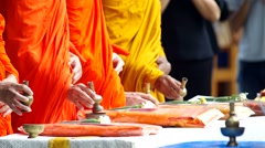 Monks poured water from small water pot to the conteiner Stock Footage