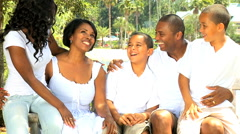 Social leisure African American family outdoors garden daughter sons recreation Stock Footage