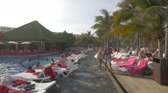 Walking between the chaise lounges at Grand Oasis Cancun in the afternoon Stock Footage
