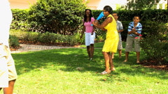 African American male female family children sport baseball playing outdoor Stock Footage