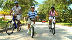 ethnic parents boy family bicycle cycling outdoor healthy lifestyle together - stock footage