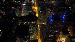 Aerial view of illuminated Chicago by night with a top of Franklin Center Stock Footage