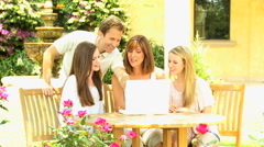 young male female Caucasian family happy outdoors laptop computer social leisure - stock footage