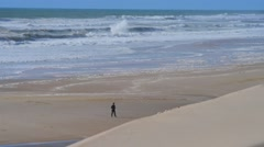 Sea, Sand and Dunes-People playing and walking on the beach Stock Footage