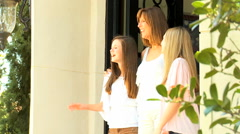 Caucasian male female family daughters luxury home welcome property business Stock Footage