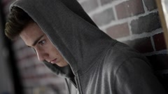Teennager Boy in hooded top Stock Footage