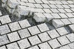 Paving stones broken and cracked Stock Photos
