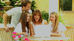 Caucasian male female parents teenage girls outdoors wireless laptop device Stock Footage
