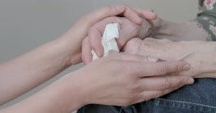 Comforting senior hands gently Stock Footage