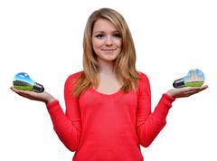 Girl holding in hand eco energy bulbs  Stock Photos