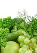 Group of green vegetables and fruits on white background Stock Photos