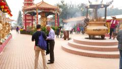 Entering courtyard of Buddhist monastery, Main Plaza, visitors and believers - stock footage